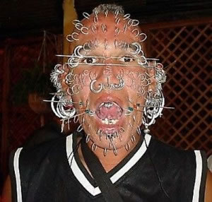 man with many piercings